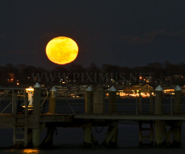 Largest Moon Ever, Captured From Around the World