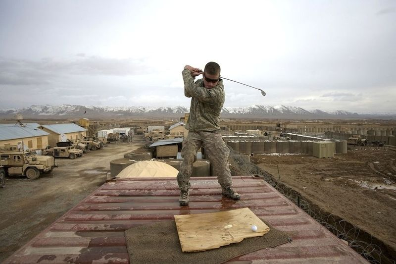American soldiers play golf during war