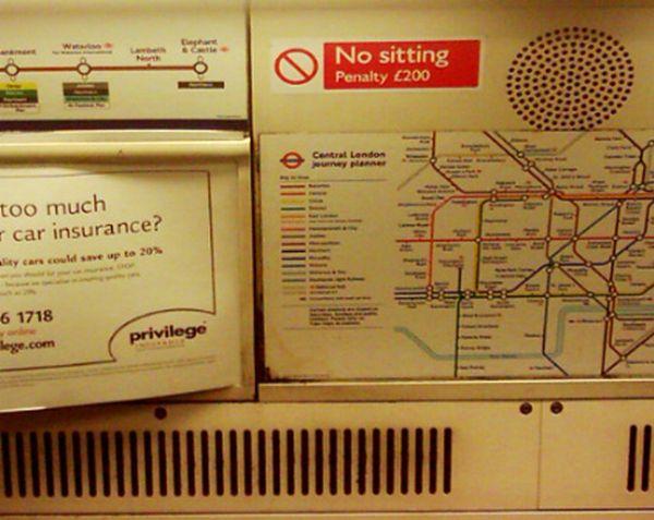 Guerilla Artists Doctoring  Signs on London Transport