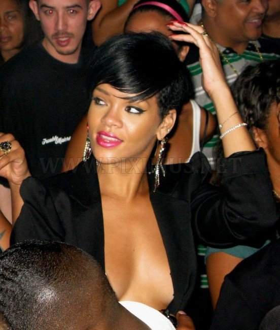 Rihanna lit up in a frank costume