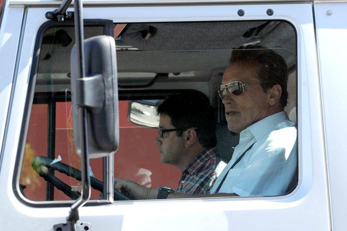 Arnold Schwarzenegger Riding a Monster Truck