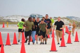 Marines Help Boy With Prosthetic Leg Finish Race