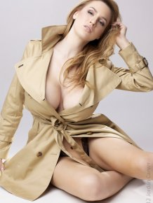 Jordan Carver in a raincoat