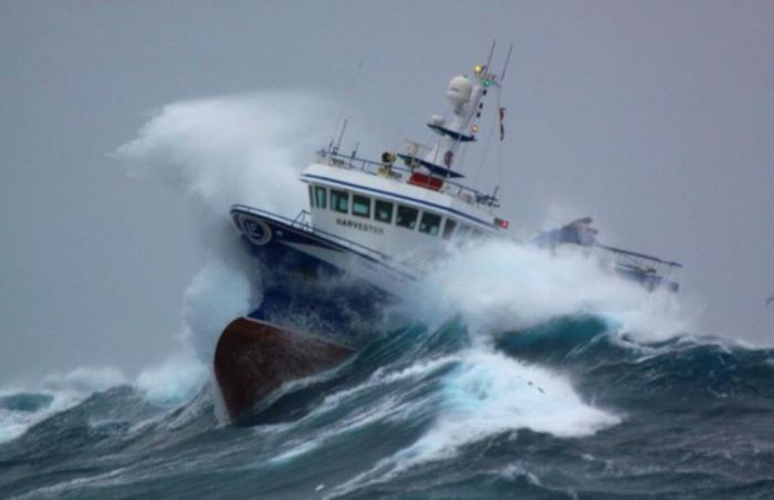 Fishing Boat Battered by Waves