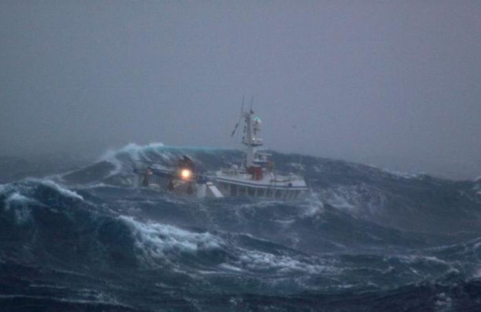 Fishing Boat Battered By Waves Others