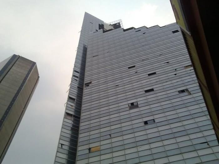 Thousands of People Live in Abandoned Skyscraper