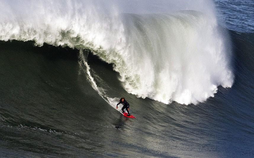 Hawaiian surfer Garrett McNamara on a huge wave in Portugal