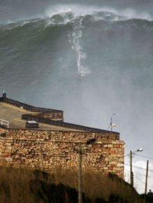 Hawaiian surfer Garrett McNamara on a huge wave in Portugal