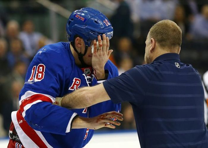 Marc Staal Takes Puck to the Face
