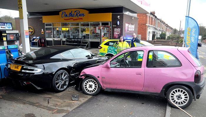 Aston Martin DBS vs Pink Vauxhall Corsa