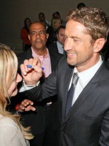 Gerard Butler Autographs a Fan's Forehead