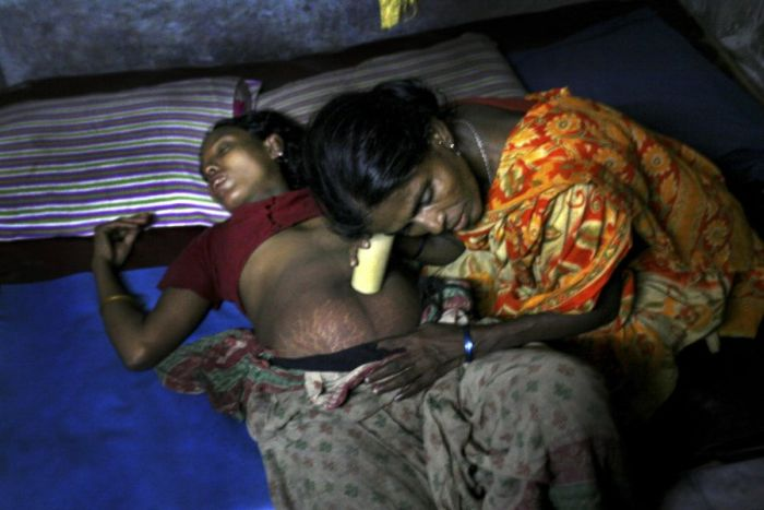 Woman Gives Birth in the Slums of Bangladesh