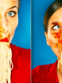 Women Eating Pasta Stock Photos
