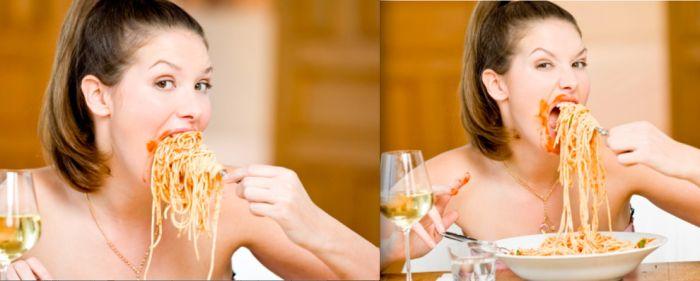 Women Eating Pasta Stock Photos