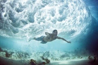 Divers Beneath the Waves