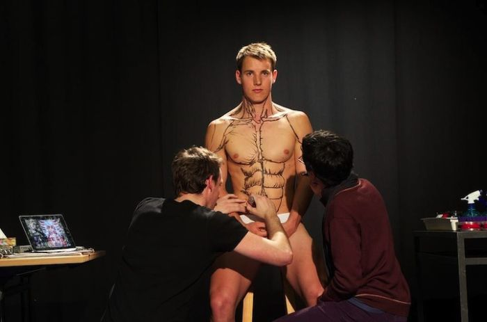 Students Painting a Live Body