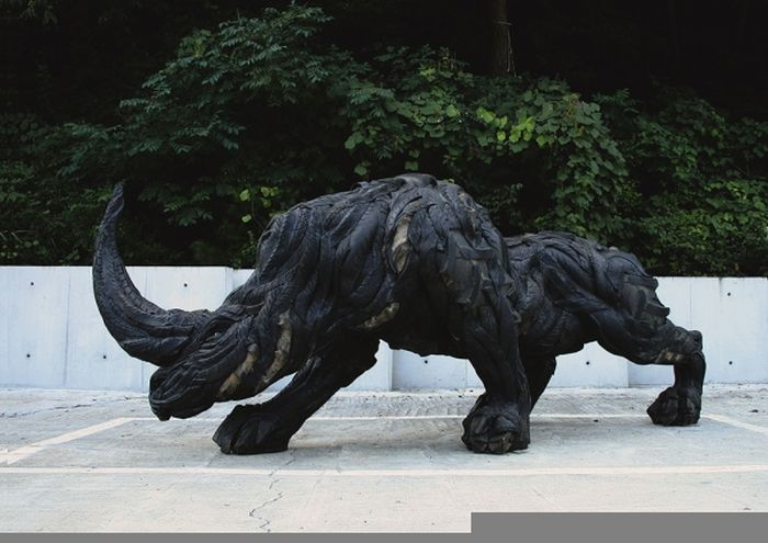 Sculptures made out of old tires art for Old tire art
