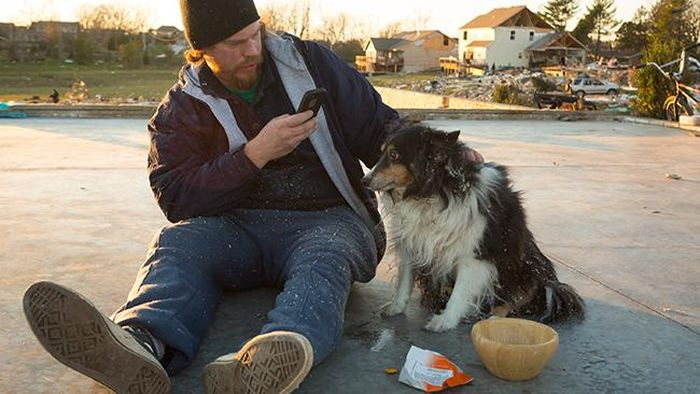 Man Finds His Dog after Illinois Tornado