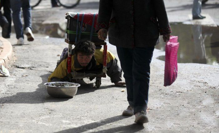 Chinese Beggar Busted