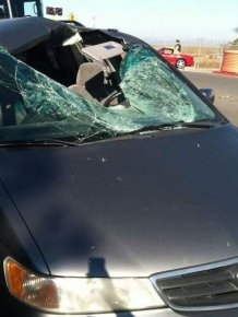 Tire Flies Into a Car's Windshield