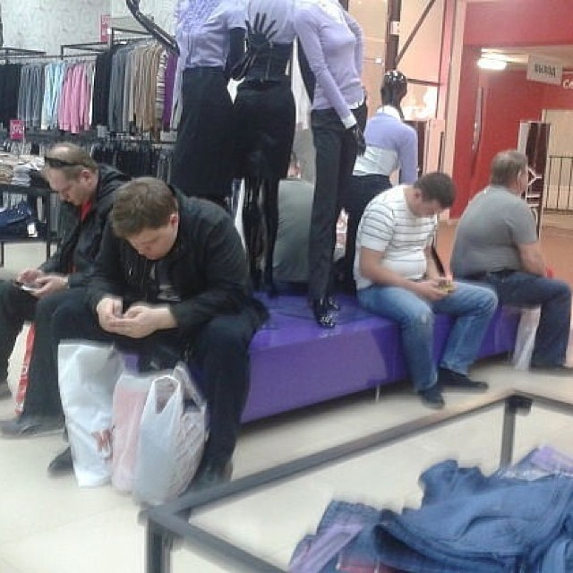 Men on shopping with women