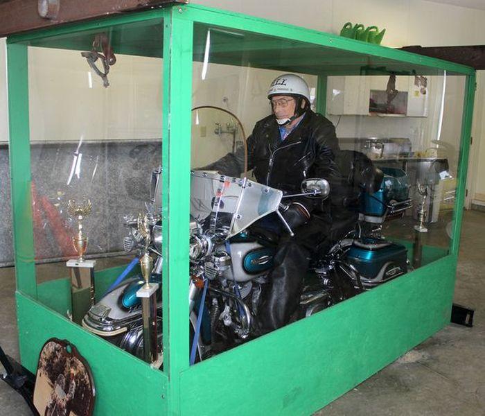 Giant Transparent Casket with a Bike
