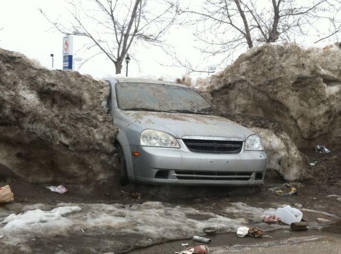 Car Frozen In Snowbank