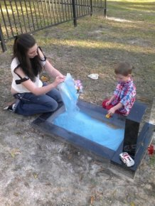 A Grave with a Sandbox