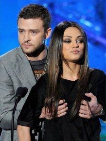 Justin grabs Mila Kunis