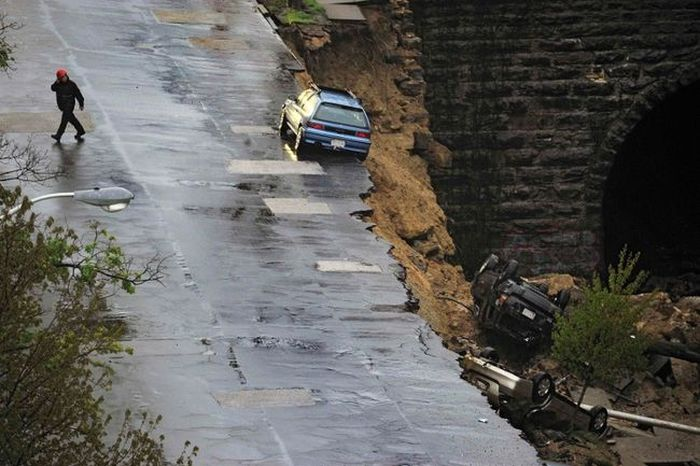 Baltimore Road Collapses And Takes Cars With It