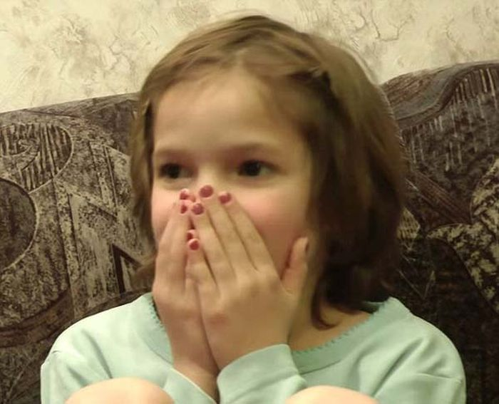 See This Girl's Reaction To Her Own Birth