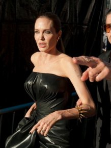 Brad Pitt Gets Hit In The Face At Maleficent Premiere