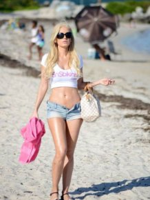Ana Braga Shows Herself Off In String Bikini