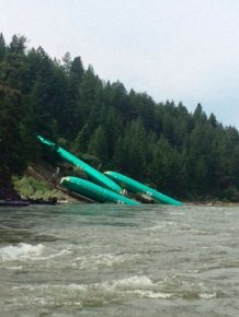 A Train Carrying Planes Derails