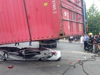 Car Gets Squashed By A Container Truck