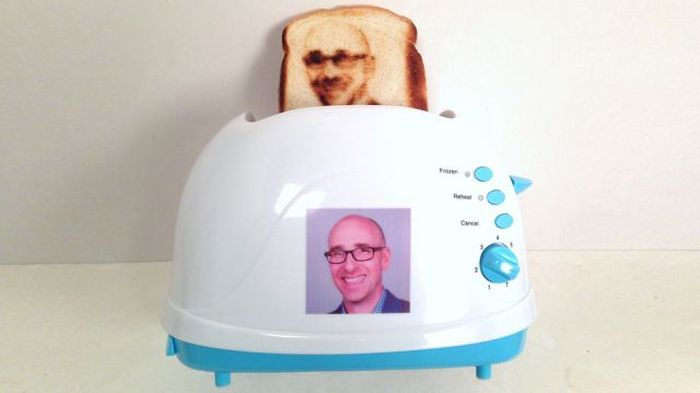 Man Puts His Face On A Piece Of Toast