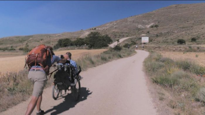 Man Takes Disabled Friend On A Pilgrimage