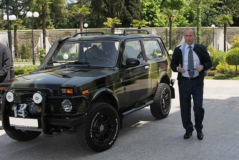 Russian president Vladimir Putin with cars