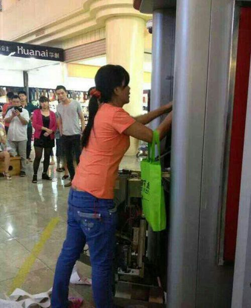 Woman Breaks ATM