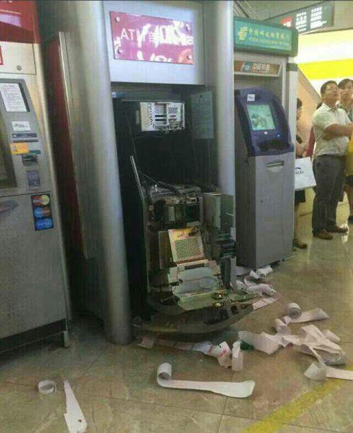 Woman Breaks ATM