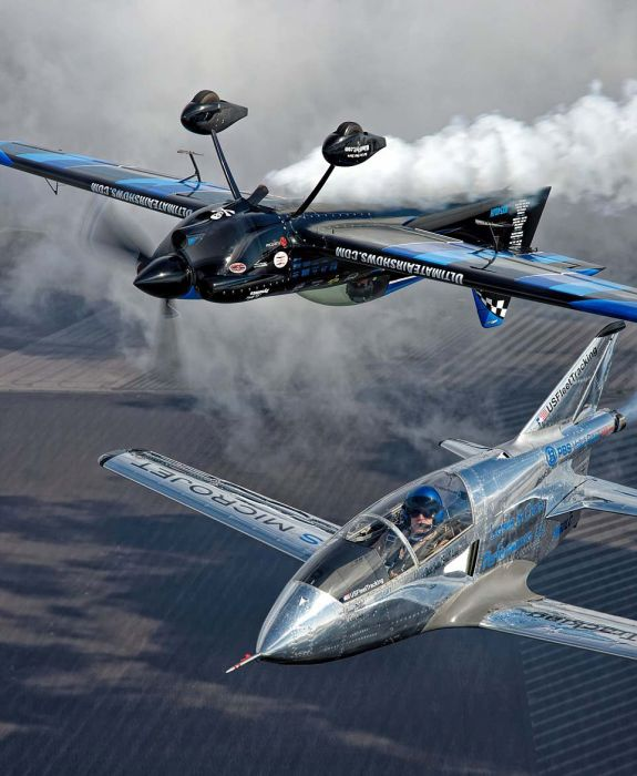 Daredevil Pilot Photobombs Other Planes While Flying Upside Down