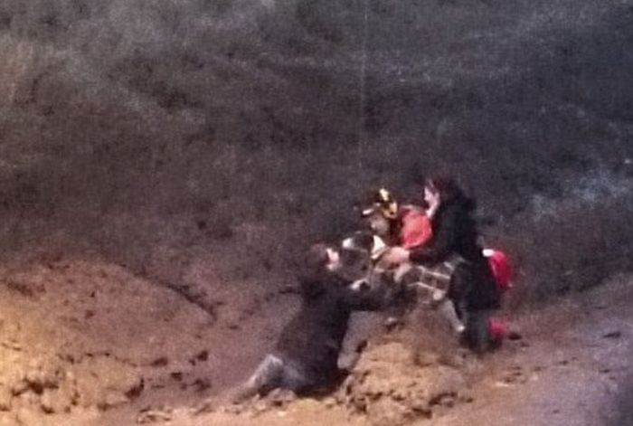 Couple Gets Stuck In The Mud