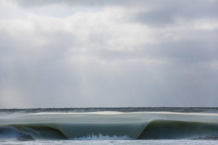 Photographer Captures Incredible Frozen Ocean Waves Off The Coast
