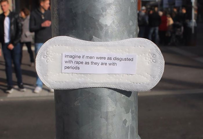 Woman Posts Period Pads With Feminist Messages All Over Her City