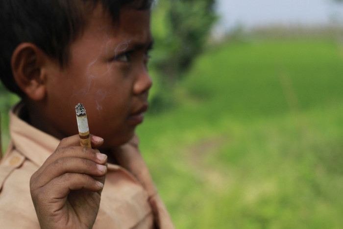 This 7 Year Old Boy Smokes Three Packs A Day