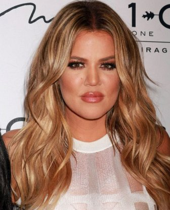 Khloe Kardashian Shows Off Her Body In A Tight White Dress