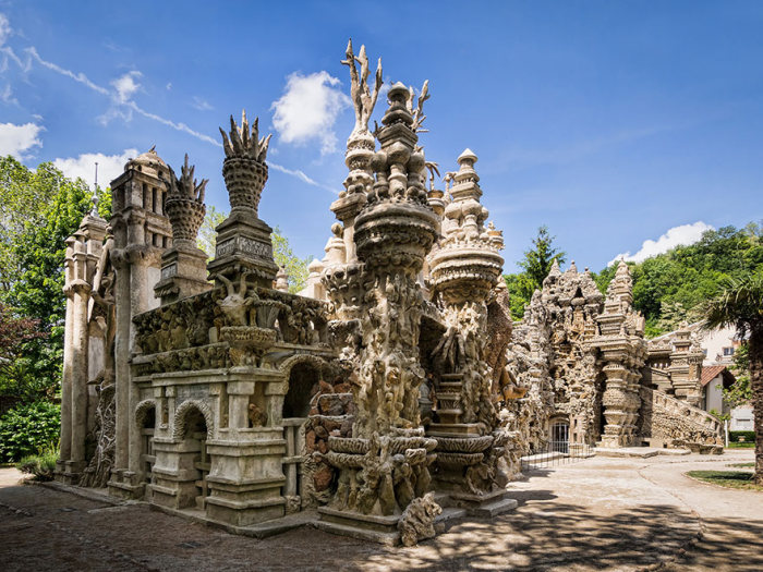 French Mailman Spends 33 Years Building A Palace With Pebbles