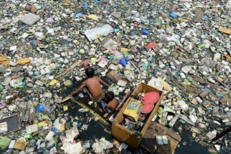 Father And Son Travel Through Garbage For $3 Dollars A Day