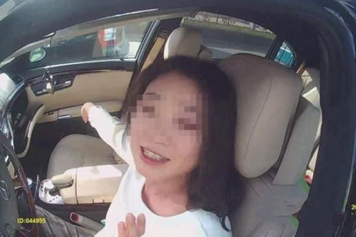 Drunk Driving Female Poses For A Selfie