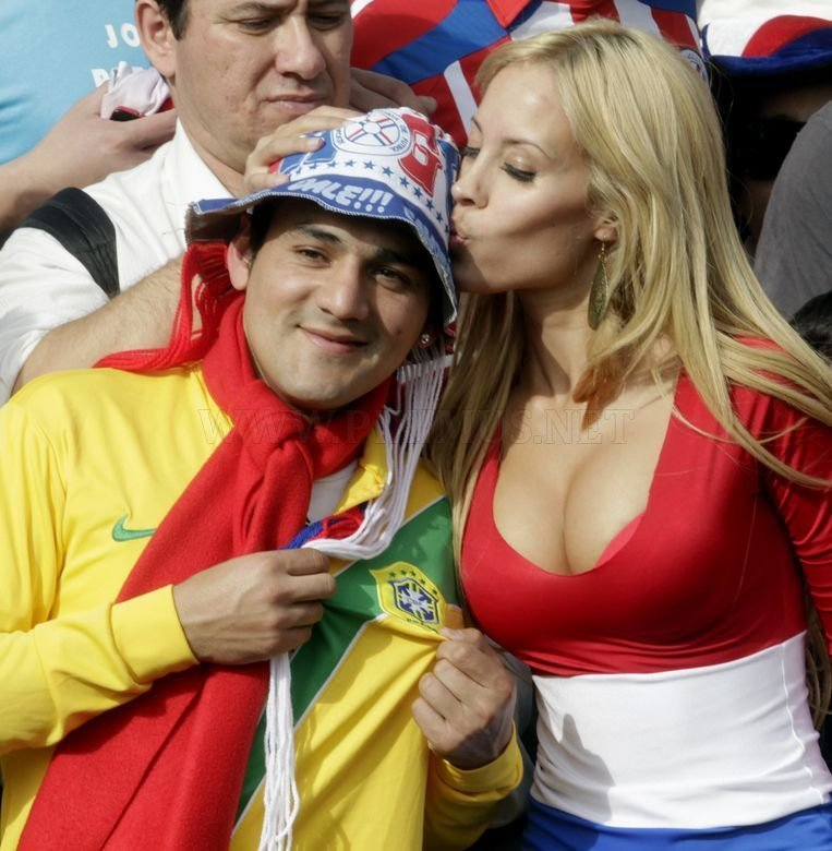 This cute Paraguay fan is, so far, the most famous fan of FIFA World Cup in South Africa. Her photos are everywhere - Acidcow, Digg, Reddit, etc :) Her name is ... dating